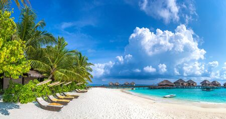 Panorama of Wooden sunbed on tropical beach in the Maldives at summer day