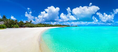Panorama of Tropical beach in the Maldives at summer day Stock Photo