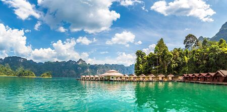 Panorama of Traditional Thai bungalows at Cheow Lan lake, Ratchaprapha Dam, Khao Sok National Park in Thailand in a summer day