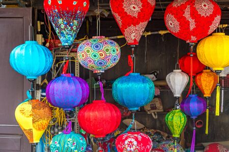HOI AN, VIETNAM - JUNE 8, 2018: Colorful traditional lanterns on the old street of Hoi An, Vietnam in a summer day