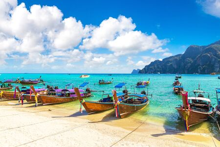 Traditional thai longtail boat at Log Dalum Beach on Phi Phi Don island, Thailand in a summer day