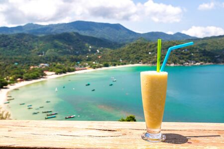 Fresh organic mango shake in restaurant on Ao Thong Nai Pan Noi beach on Koh Phangan island, Thailand in a summer day