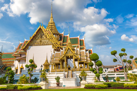 Grand Palace and Wat Phra Kaew (Temple of the Emerald Buddha) in Bangkok in a summer day
