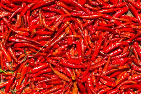 Red chili peppers background in vegetables market in Bangkok, Thailand in a summer day