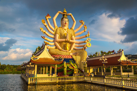 Statue of Shiva in Wat Plai Laem Temple, Samui, Thailand in a summer day Redakční