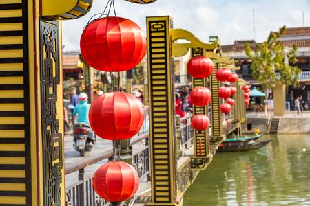 Traditional Colorful lanterns on Cau An Hoi bridge in Hoi An, Vietnam in a summer day Redakční