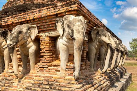 Wat Sorasak Temple (Elephant Temple) in Sukhothai historical park, Thailand in a summer day