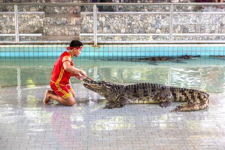 PATTAYA, THAILAND - MARCH 29, 2018: Crocodile show in Pattaya, Thailand in a summer day