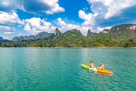 SURAT THANI, THAILAND - MARCH 25, 2018: Canoeing at Cheow Lan lake, Ratchaprapha Dam, Khao Sok National Park in Thailand in a summer day Redakční
