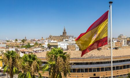 Spain flag and panoramic aerial view of Sevilla in a beautiful summer day, Spain Archivio Fotografico