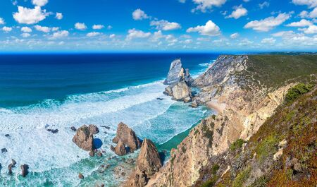 Cabo da Roca. Cliffs and rocks on the Atlantic ocean coast in Sintra in a beautiful summer day, Portugal Stock Photo