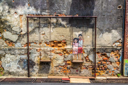 PENANG, MALAYSIA - FEBRUARY 22, 2020: Mural graffiti in Georgetown on Penang island, Malaysia Editorial