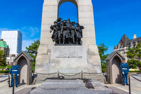 OTTAWA, CANADA - APRIL 2, 2020: Guards  and The National War Memorial in Ottawa in a sunny day, Canada