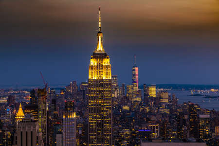 NEW YORK CITY, USA - MARCH 29, 2020: Panoramic aerial view of Manhattan at night in New York City, NY, USA