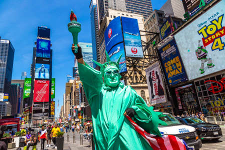 NEW YORK CITY, USA - MARCH 15, 2020: Street artist dressed up as Statue of Liberty in Times Square, New York City, USA Editorial