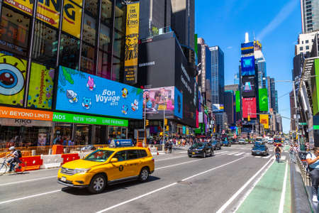 NEW YORK CITY, USA - MARCH 15, 2020: Yellow taxi on Times Square is a symbol of New York City, USA