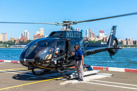 NEW YORK CITY, USA - MARCH 29, 2020: Helicopter flying at manhattan in New York City, NY, USA