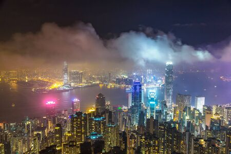 Panoramic night view of Hong Kong business district in a summer night