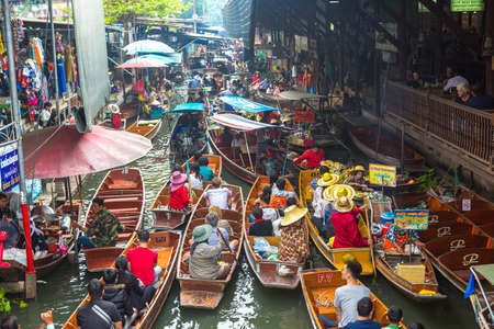 BANGKOK, THAILAND - MARCH 22, 2018: Floating market in Thailand in a summer day