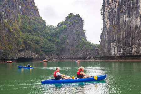 HALONG, VIETNAM - JUNE 17, 2018: Tourists exploring cave in Halong bay, Vietnam in a summer day Editoriali
