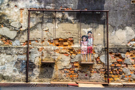 PENANG, MALAYSIA - FEBRUARY 22, 2020: Mural graffiti in Georgetown on Penang island, Malaysia