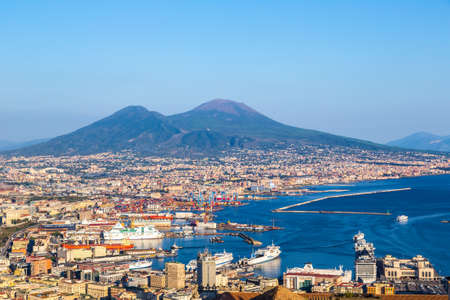 NAPLES, ITALY - AUGUST 19, 2014: Napoli (Naples) and mount Vesuvius in the background at sunset in a summer day, Italy, Campania