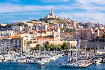 MARSEILLE, FRANCE - JULY 12, 2014: Aerial panoramic view on basilica of Notre Dame de la Garde and old port in Marseille, France Editorial