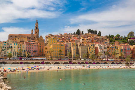 MENTON, FRANCE - JUNE 13, 2016: Colorful old town and beach in Menton on french Riviera in a beautiful summer day, France
