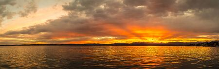 Panorama of Sunset on Garda lake in Italy in a beautiful summer evening