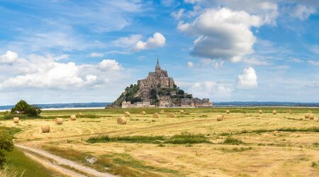 Panorama of Mont Saint Michele abbey in a beautiful summer day, France