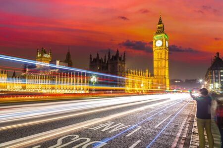 London Big Ben and traffic on Westminster Bridge in a beautiful summer night, London, England, United Kingdom