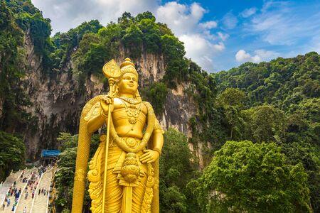Statue of hindu god Murugan at Batu cave in Kuala Lumpur, Malaysia at summer day
