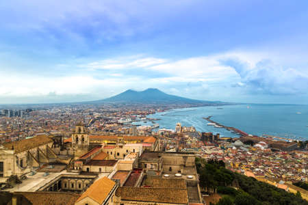 NAPLES, ITALY - AUGUST 19, 2014: Napoli (Naples) and mount Vesuvius in the background at sunset in a summer day, Italy, Campania Redakční