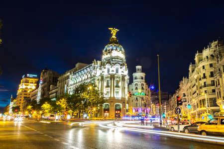 MADRID, SPAIN - JULY 11, 2014: Metropolis hotel in Madrid in a beautiful summer night on July 11, 2014 in Madrid, Spain Publikacyjne