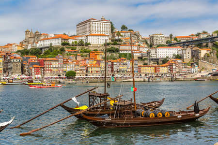 LISBON, PORTUGAL - JULY 30, 2014: Porto and old traditional boats with wine barrels in Portugal in a summer day Editoriali