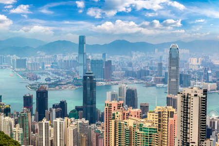 Panoramic view of Hong Kong business district in a summer day