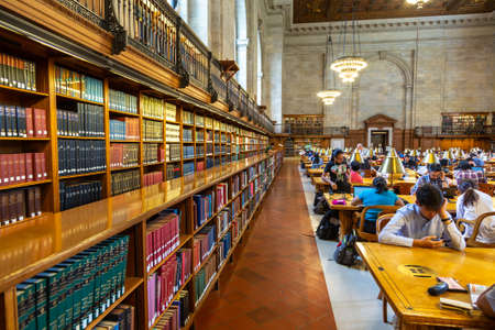 NEW YORK CITY, USA - MARCH 15, 2020: Books at Main reading room of the New York Public Library, New York City, USA Redakční