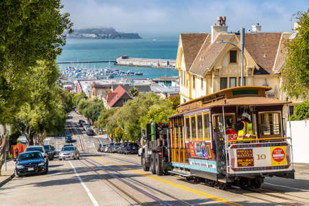 SAN FRANCISCO, USA - MARCH 29, 2020: The Cable car tram and Alcatraz prison island on a background in San Francisco, California, USA