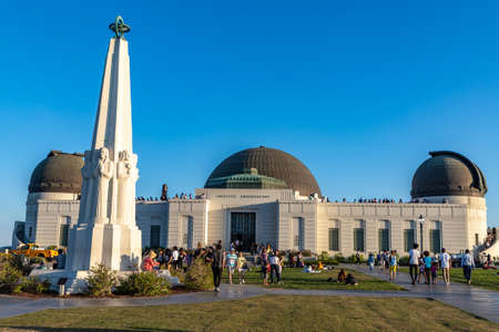 LOS ANGELES, HOLLYWOOD, USA - MARCH 29, 2020: Griffith Observatory and Astronomers Monument in Los Angeles, California, USA