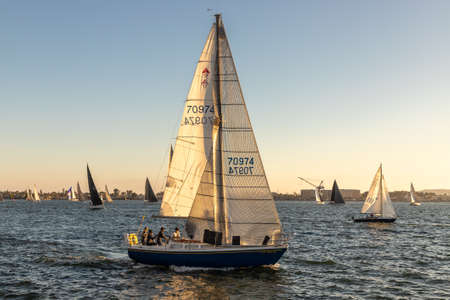 SAN DIEGO, USA - MARCH 29, 2020: Many sail boats sailing in the bay in San Diego at sunset, California, USA