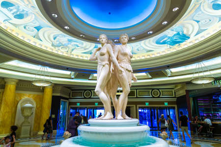 LAS VEGAS, USA - MARCH 29, 2020: Golden statues on top of fountain at the lobby of Caesars Palace Las Vegas Hotel and Casino in Las Vegas, Nevada, USA