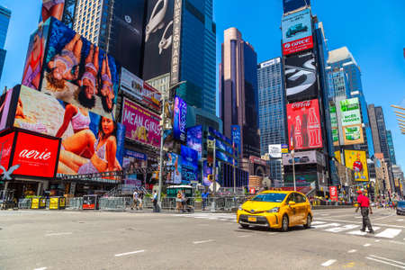 NEW YORK CITY, USA - MARCH 15, 2020: Yellow taxi on Times Square is a symbol of New York City, USA Editoriali