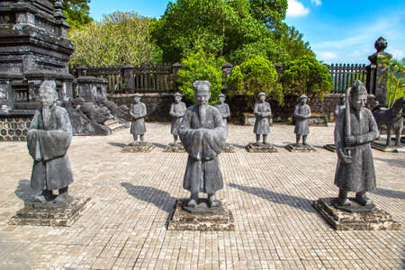 Tomb of Khai Dinh with Manadarin hnour guard in Hue, Vietnam in a summer day