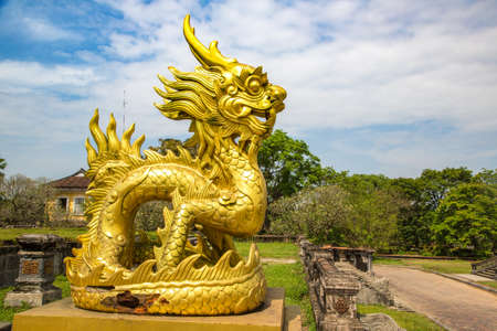 Golden dragon statue located inside Imperial Royal Palace, Forbidden city in Hue, Vietnam in a summer day