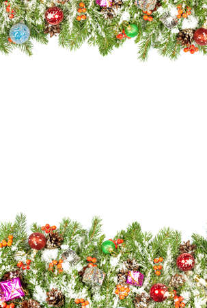 Christmas background with balls and decorations and snow, holly berry, cones isolated on white Imagens