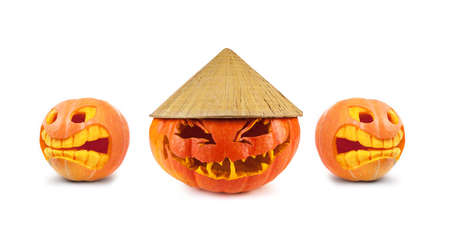 Halloween pumpkin with Asian conical hat isolated on a white background