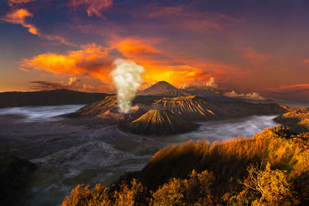 Sunrise at volcano Bromo, Java island, Indonesia. Panoramic aerial view Фото со стока