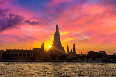 Wat Arun Temple at beautiful sunset in Bangkok Thailand. Фото со стока