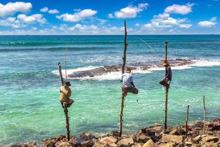Local Fisherman fishing in traditional way at the beach in Sri Lanka