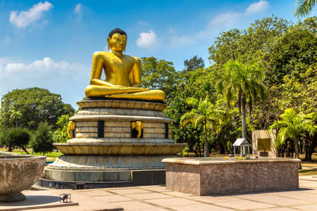 Giant seated Buddha in the Viharamahadevi park in Colombo, Sri Lanka Фото со стока